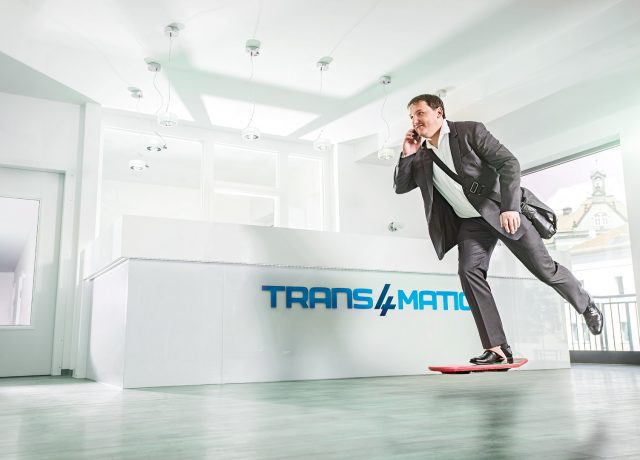 Trans4mation IT GmbH Imagemotiv Businessman on Hoverboard at the Office