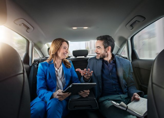 8x8 Chauffeurservice Campaign Peoplephotography Business Woman and Man Meeting on Backseat of a Taxi